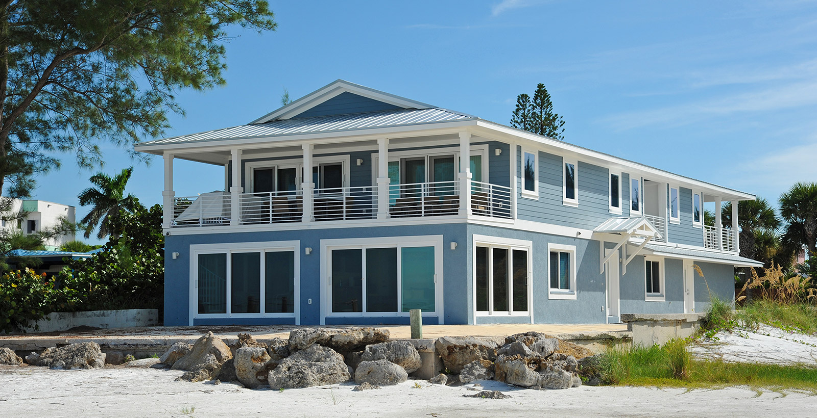 Learn about the best practices for building storm-resistant waterfront custom homes.
