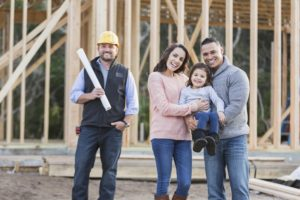 A family with a young child is excited about building their new home