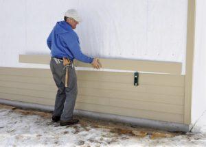 A man replaces home siding